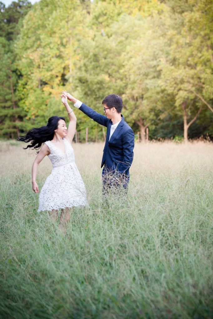 Engagement session at McDaniel farm near tall grass field