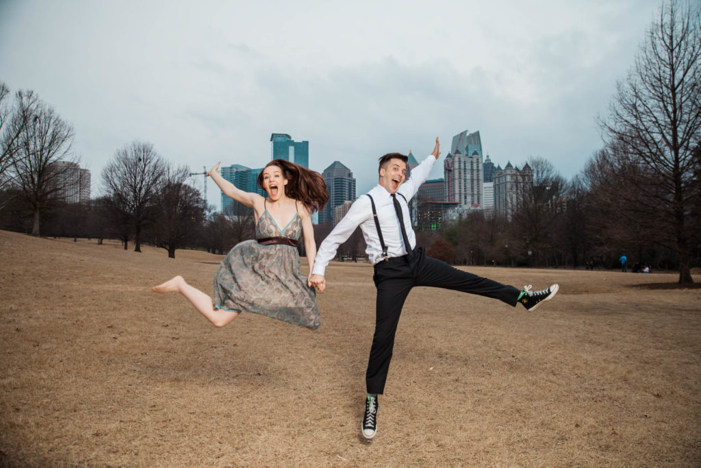 Jumping engagement photo at Piedmont Park GA