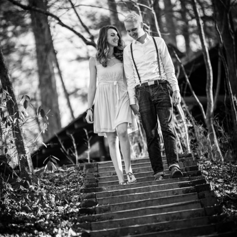 Engagement session at Atlanta with couple walking down stairs