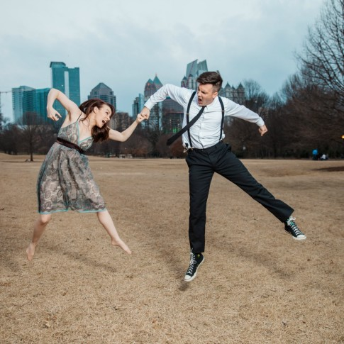 Engagement session couple having fun jumping at Piedmont Park Atlanta