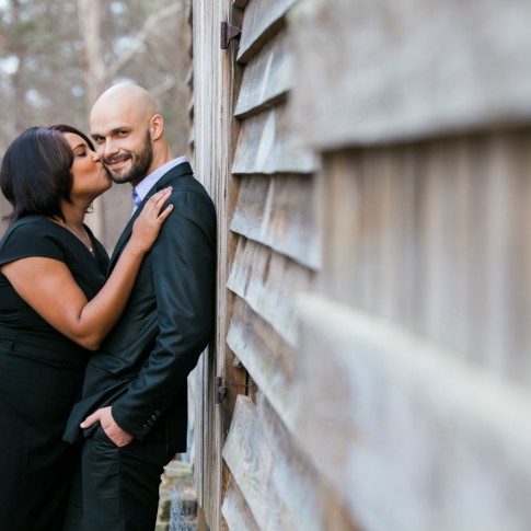 Engagement session near barn at McDaniel Farm Park