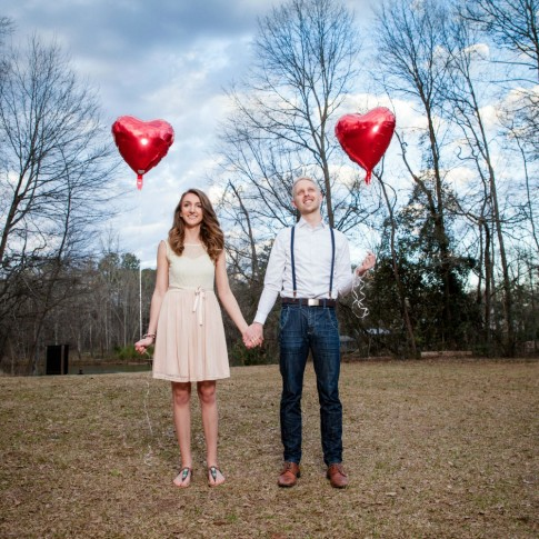 Engagement session with red balloon