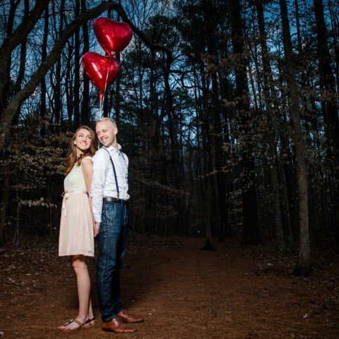 Engagement session with red balloon as props