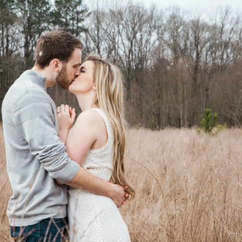 Garrard landing park engagement session couple kissing with tall grass as background