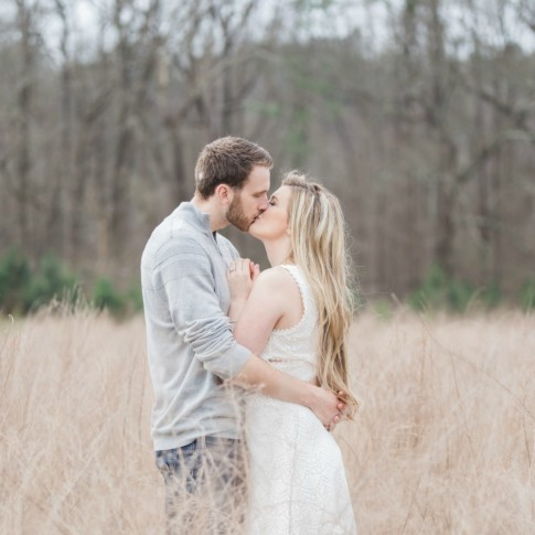 Garrard landing park engagement session with couple kissing on tall grass