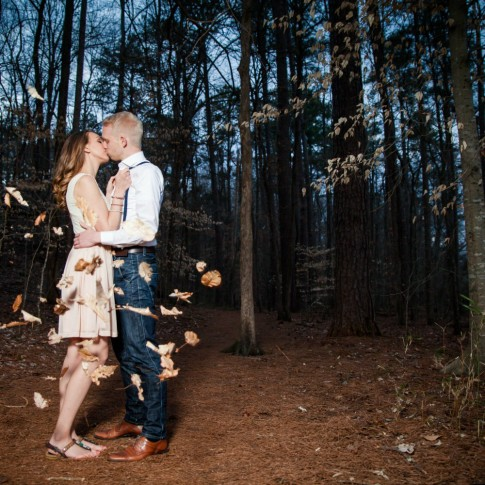 Gary Lun Photography engagement session in the woods with leaves flying by