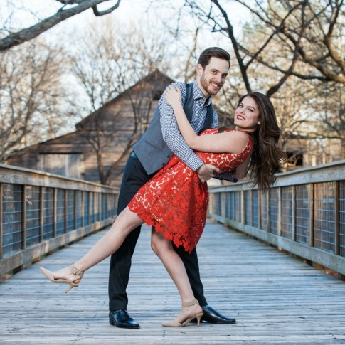 McDaniel farm park engagement session couple dip beautifully on bridge