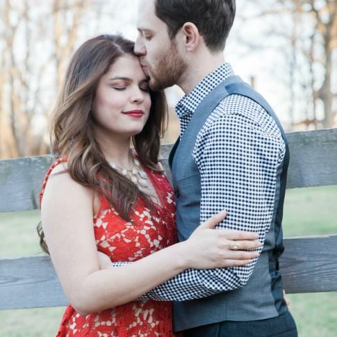 McDaniel farm park engagement session couple kissing in front of fence