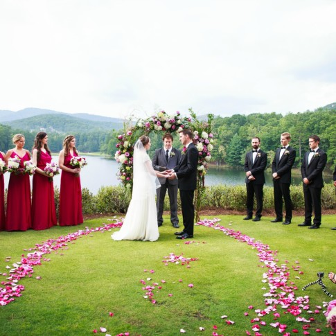 Outdoor wedding ceremony facing lake