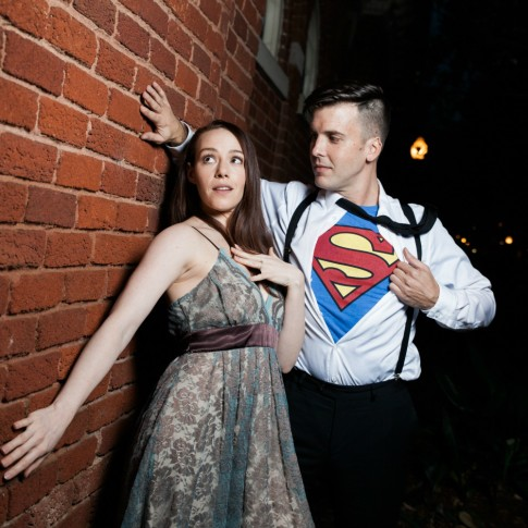 Piedmont Park Atlanta engagement session with superman custome near red brick wall