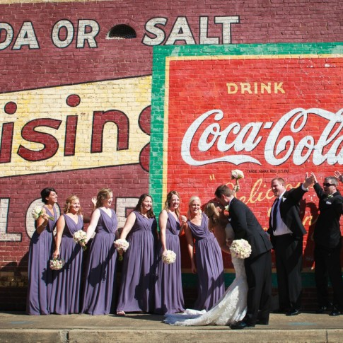 Wedding party posing happily at downtown acworth