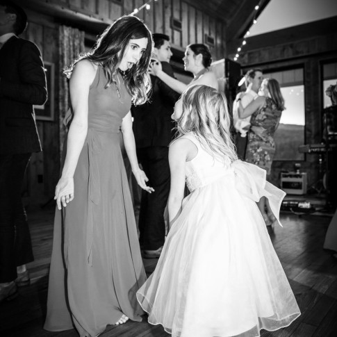 Wedding reception bridsmaid dancing with flowergirl