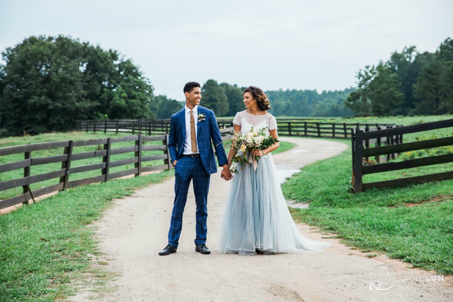 Atlanta Serenbe Farm Styled ShootI bride and groom holding hards in front of barn