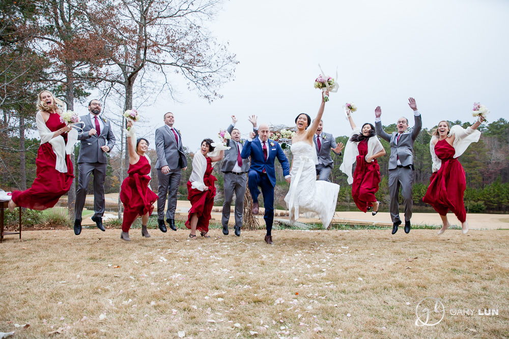 The River Club Suwanee wedding party jumping shot