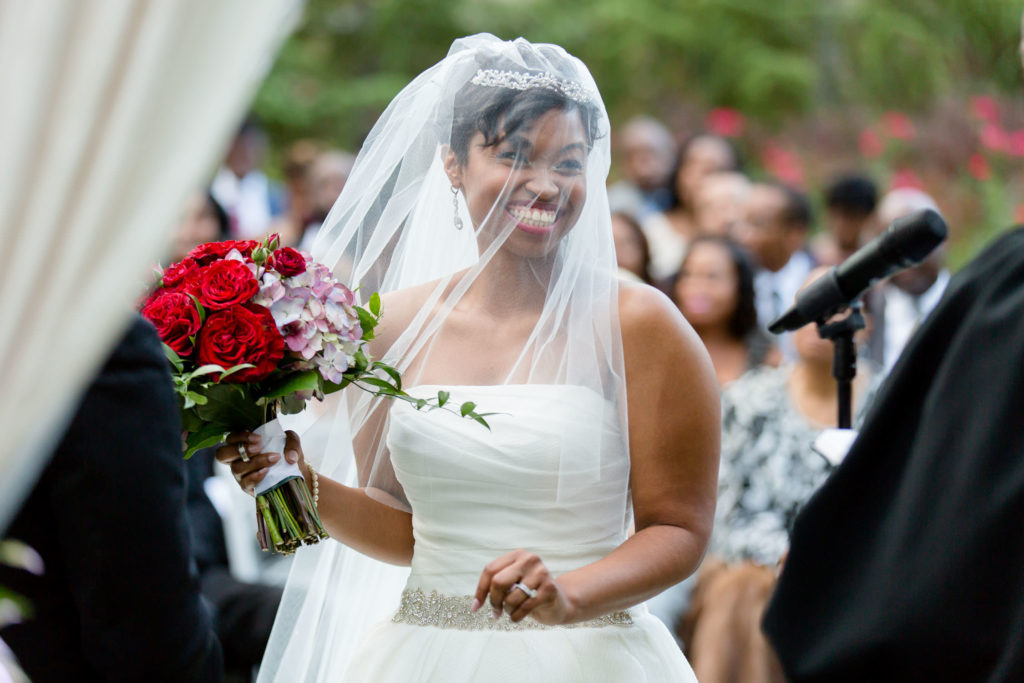 Bride looking so happy after ring exchange