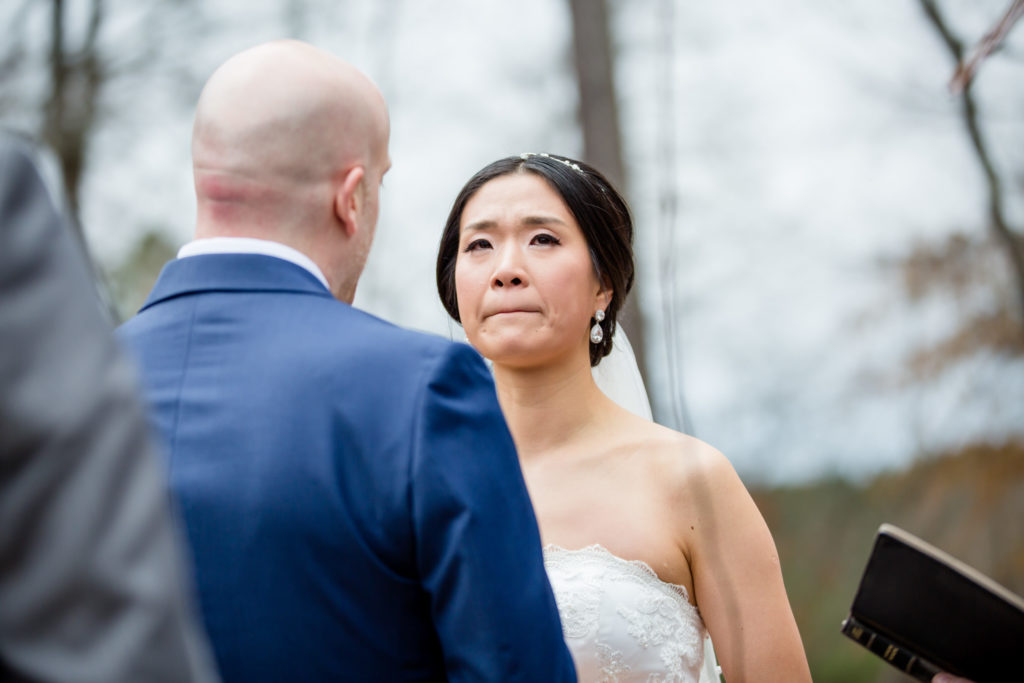 Emotional bride during wedding ceremony at the River Club GA