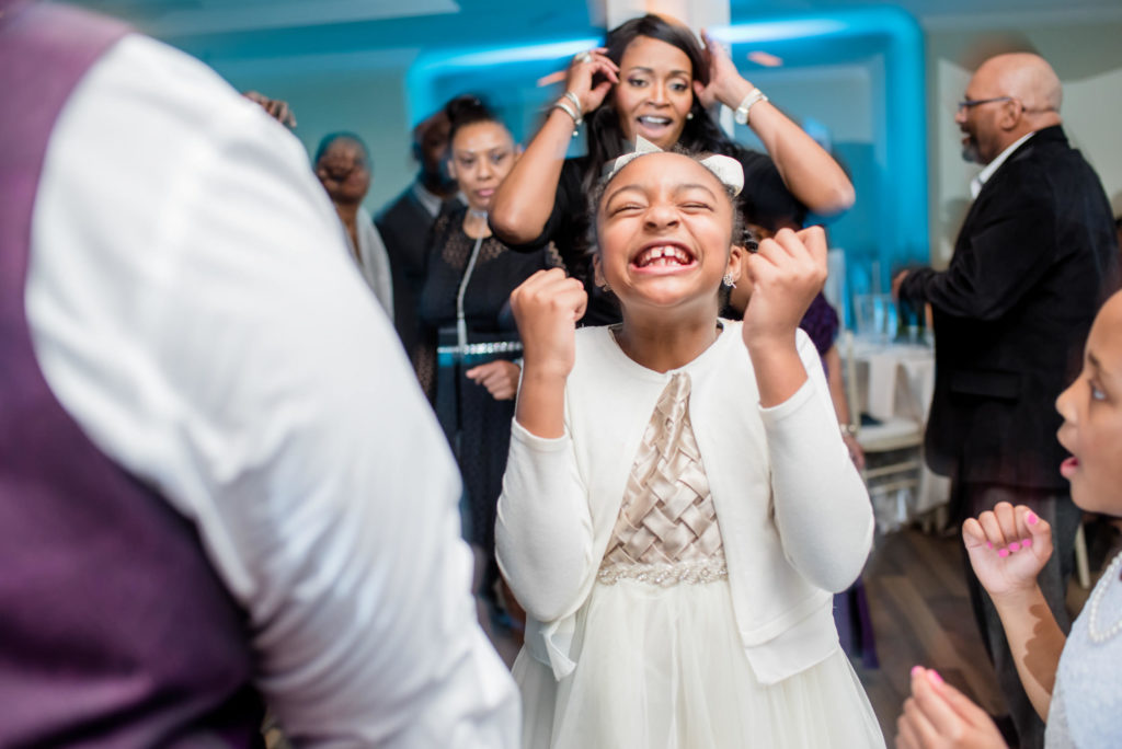Flowergirl dance looking excited at Little Gardens Atlanta