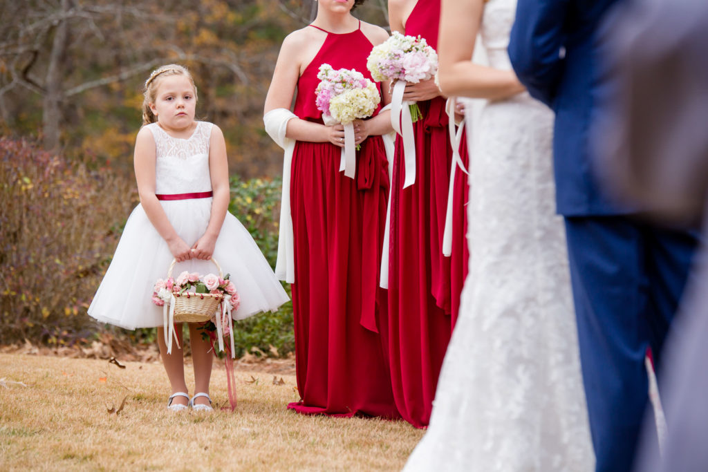 Flowergirl during ceremony at the River Club by Gary Lun Photography