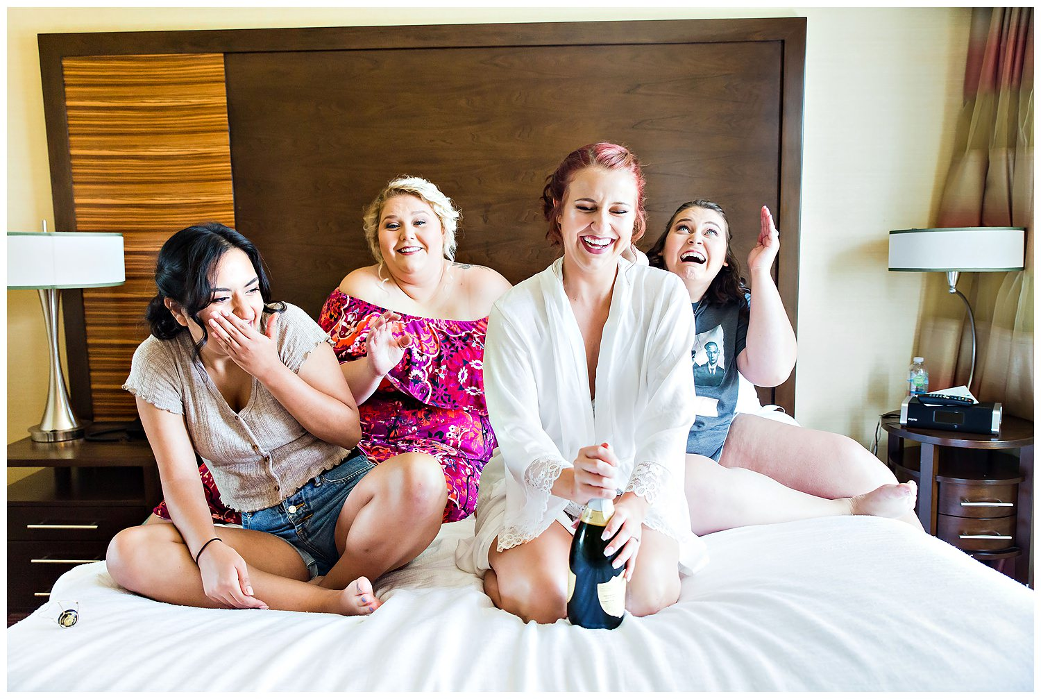 Champagne toast on bed