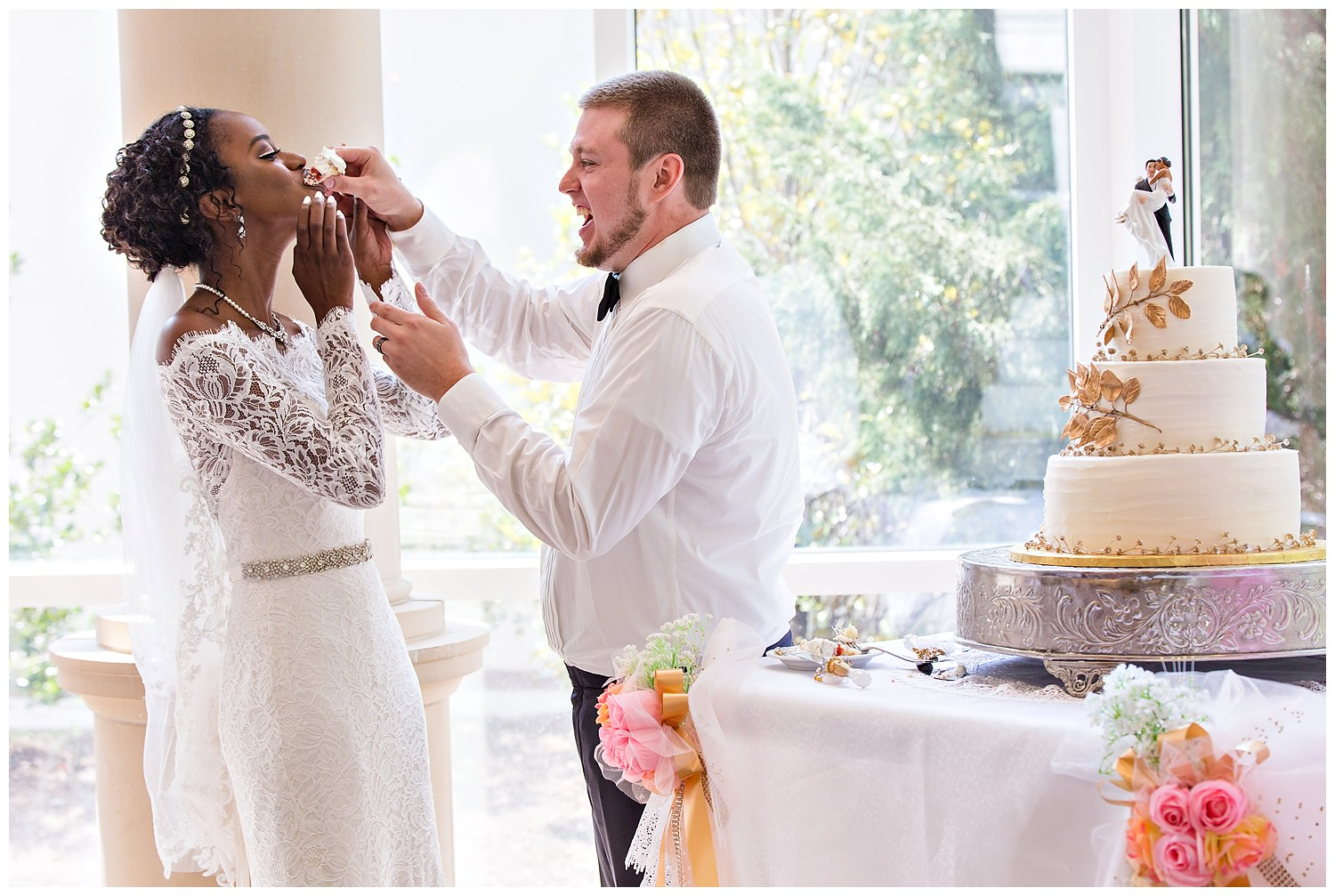 Feeding each other wedding cake